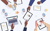 Table top view. Cartoon people working with laptops and tablets. Teamwork scene in office or co-working. Hands holding devices and writing notes. Effective workflow, vector illustration