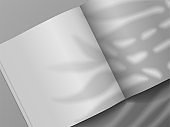 Open book. Realistic brochure mockup with plant shadow overlay effect. 3D notebook and leaves shade. Top view of empty paper sheets. Vector magazine or textbook pages with copy space