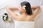 A beautiful woman is relaxing and having massage in spa resort, Massage and beauty treatment concept.