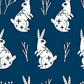Seamless pattern with mystic white rabbit or hare and branches
