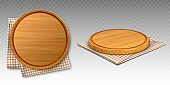 Wooden pizza and cutting boards on kitchen towel