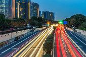 traffic light through city at night in china