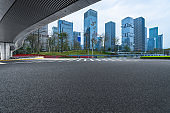 empty asphalt road with city skyline background in china