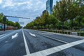 city road through modern buildings in tianjin