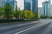 """empty asphalt road front of modern buildings""""n"""