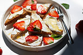 Healthy food breakfast strawberry toast with butter cream