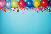Flat party decoration concept on pastel blue background from above