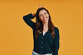 Playful young woman in casual clothing making a face