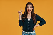 Attractive young woman in casual clothing gesturing and smiling