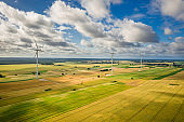 Wind turbines on field. Aerial view of countryside wind farm.