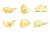 Yellow potato chips with salt and season on a white isolated background