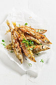 Fried smelt fish and chips with salt and herbs