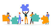 People with puzzle concept, man woman holding puzzle jigsaw pieces, standing together