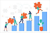 Business people climbing up stairs, holding puzzle jigsaw pieces to achieve goals
