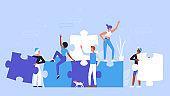 People building creative puzzle concept, holding jigsaw pieces to create success idea