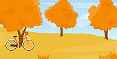 Autumn countryside landscape of forest park or garden, fall village nature and bicycle