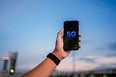 Business people use global communication phones in the 5g system.