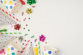 Above photo of cups confetti party tubules and birthday hat isolated on the white background with empty space