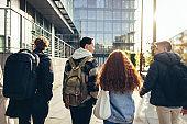 Teenagers walking in college campus