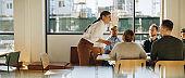 Entrepreneur talking in staff meeting