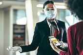Woman using vaccine passport for air travel during pandemic
