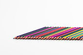 Craft and Creativity Ideas. Closeup of  Various Colorful Pencils Placed Together in Row. Isolated Against White.Horizontal Image
