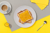 Delicious toast with lemon jam on gray background