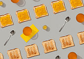 Pattern with toast and lemon jam on gray background