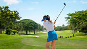 Golfer sport course golf ball fairway. People lifestyle woman playing game golf tee of on the green grass.