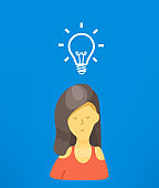 Thinking businesswoman with idea sign. Idea concept