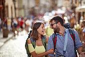 Tourist couple sightseeing; Traveller lifestyle