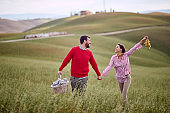 A young cheerful couple feeling happy in the nature together. Love, relationship, together, nature