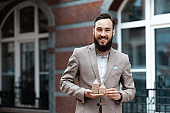 Real estate agent. Smiling man with miniature houses in his hands. Apartment rent, home insurance