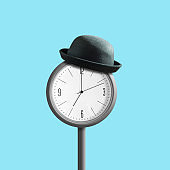 Street clock in a hat, on a blue background. Business and time concept.