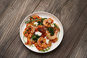 Gnocchi with shrimp and baked tomatoes. Italian seafood