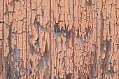 Old wood surface. Peeling paint. Wooden boards. A fence made of boards. Tree structure.