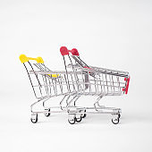 Two Empty grocery shopping cart. Isolated over white background.