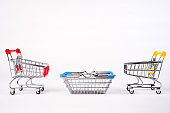 Empty grocery shopping cart. Isolated over white background.
