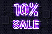 10 percent SALE glowing purple neon lamp sign on a black electric wall