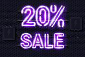 20 percent SALE glowing purple neon lamp sign on a black electric wall