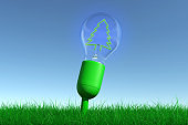 Concept of green energy technology grows in the meadow