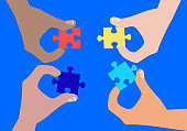 Autism awareness concept with human hands. Autism awareness concept with human hands collecting puzzle elements of blue, red, yellow colors. World autism awareness day. Colorful puzzle vector design