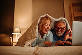 Senior couple having good time at home. Old people retirement and healthy citizens elderly concept.