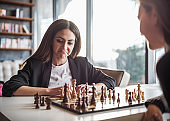 Businesswomen Playing Chess In The Office, Competition And Strategy Concept
