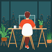 Man is sitting at a computer in a room with a large window. Concept of remote work, freelancing, teaching, e-learning, from home office at night, workplace with indoor plants. Vector illustration