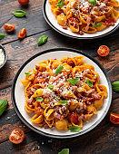 Conchiglie alla Amatriciana pasta with pancetta bacon, tomatoes and pecorino cheese. Healthy Italian food