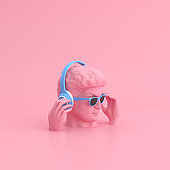 Minimal scene of sunglasses and headphone on human head sculpture, Music concept, 3d rendering.