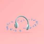 Minimal scene of music note around the headphone on background, Music concept, 3d rendering.