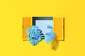 Minimal scene of window and blue plants on yellow wall background. 3d rendering.