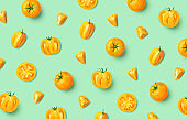 Colorful pattern of fresh whole and sliced yellow tomatoes